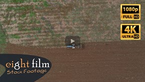Aerial Footage. Α farmer is working on a truck